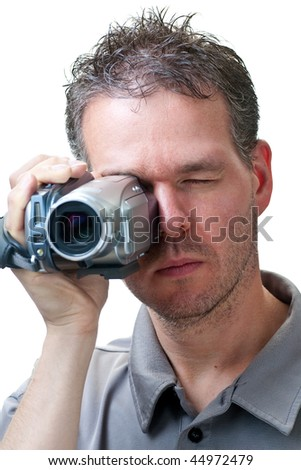 A man shooting with a video camera,  isolated on white.