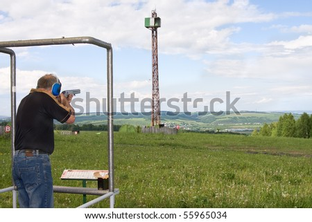 A man shoots a gun on skeet - stock photo