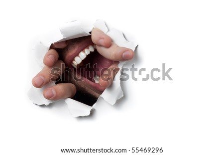 A man shouting through a hole on a thin wall or paper, isolated on white - stock photo