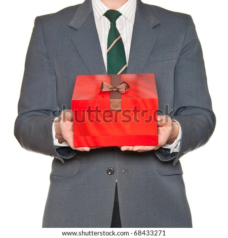 A man showing beautiful red gift box isolated on white. - stock photo
