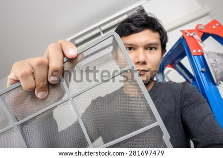 a man showing clean air filter after cleaning - stock photo