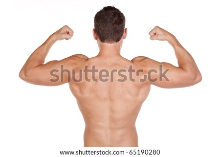 A man showing off his great back muscles, without his shirt on. - stock photo
