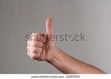 A man showing the cool sign - stock photo
