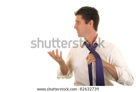 A man shows aggressive, annoyed behavior while in a conflict with his wife. - stock photo