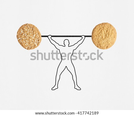 A man silhouette lifting two oat cookies