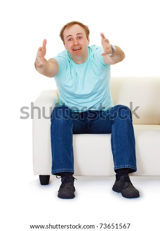 A man sits at home on the couch in despair isolated on white - stock photo