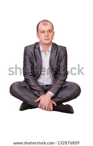 A man sits in the lotus position