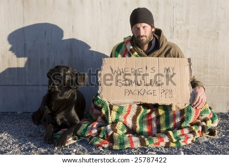 A man sits with a cardboard sign asking where his share of the stimulus package is. - stock photo