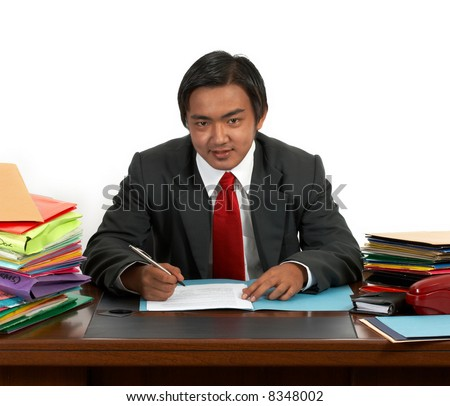 a man sitting behind his office desk - stock photo
