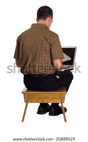 A man sitting on a wooden stool and working on his laptop computer, isolated against a white background - stock photo
