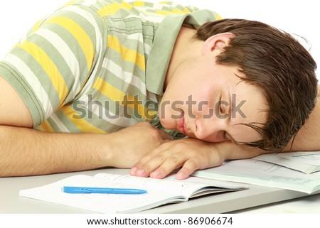 A man sleeping behind a book - stock photo