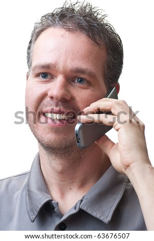 A man smiling, and talking on a flip phone, isolated on white.