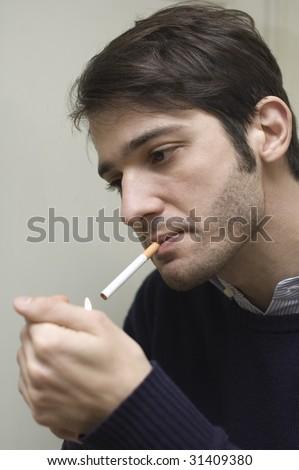a man smoke a cigarette - stock photo