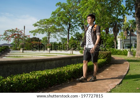 A man stand alone in the garden - stock photo