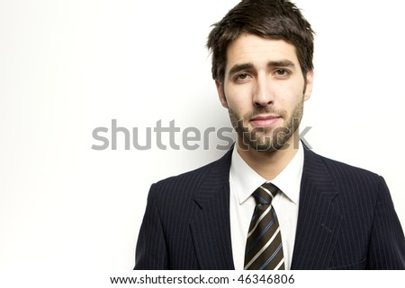 A man standing in a suit looking at the camera - stock photo