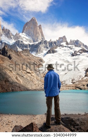 A man standing in front of Cerro Torre and laguna de Los Tres