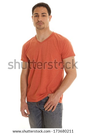 A man standing in his orange shirt looking serious. - stock photo