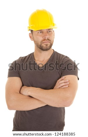 A man standing with his arms folded with a serious expression on his face. - stock photo