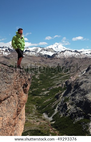 A man stands on the edge of an abyss in the Patagonia region of Argentina. - stock photo