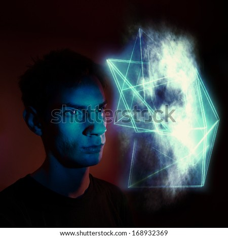 A man staring at an abstract geometric cloud-like substance symbolizing a future illusion, spiritual encounter, an illusion, a portal to another dimension, or a hallucination.  - stock photo