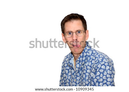 A man sticking out his tongue and making a crazy facial expression. - stock photo