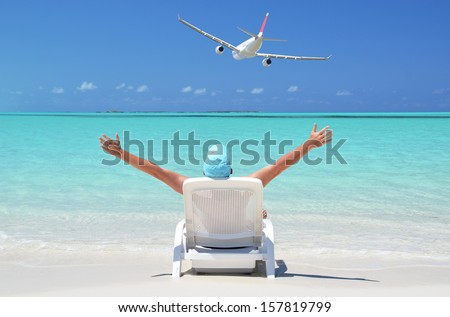 A  man sunbathing on the beach of Great Exuma, Bahamas - stock photo