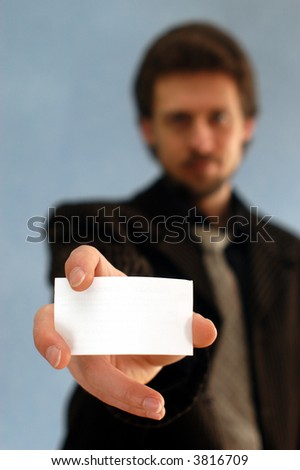 A man taking notes on a pad - stock photo