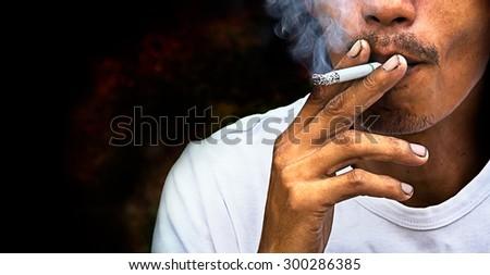 A man to smoking cigarette - stock photo