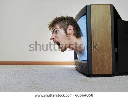 A man trapped inside of a TV, screaming for help to get out - stock photo