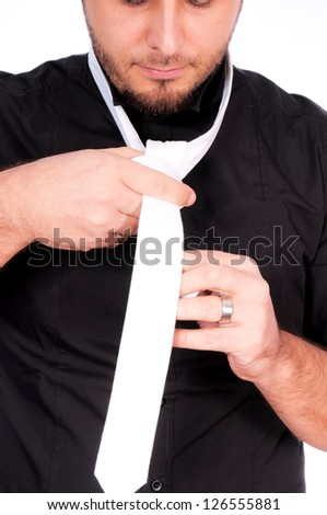 A man tries to condition white tie - stock photo