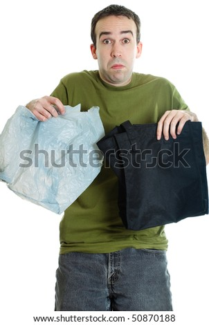 A man trying to decide between cloth or plastic bags, isolated against a white background - stock photo