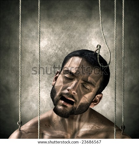 A man turned into a wooden puppuet. The concept of manipulation and slavery - stock photo