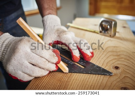 a man using a square to make a measurement - stock photo