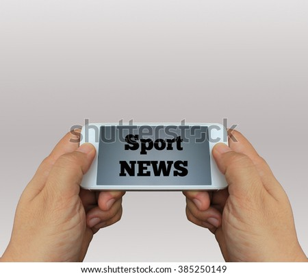 a man using hand holding the smartphone with text Sport News on display - stock photo