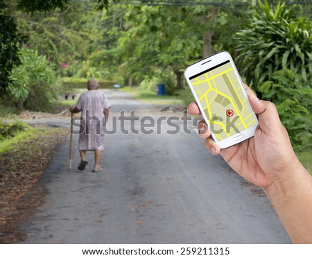 A man using Smartphone with a GPS map to find the way. - stock photo