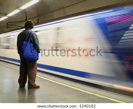 a man waiting for the train - stock photo