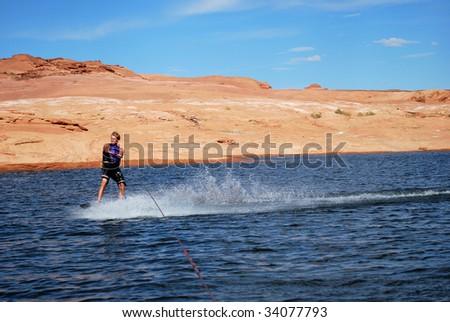 A man wake boarding at Lake Powell. - stock photo