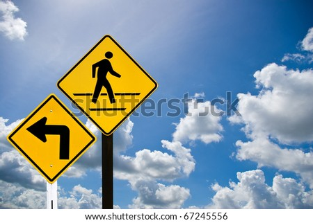 A man walking sign with turn left sign