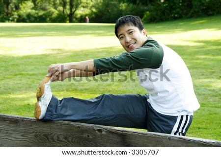 A man warming up and stretching, getting ready for workout - stock photo