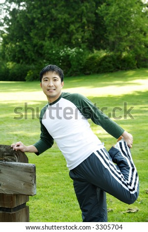 A man warming up getting ready for a workout - stock photo