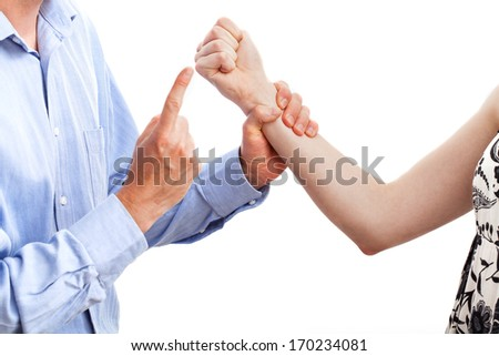 A man warning a woman threatening him with her fist - stock photo