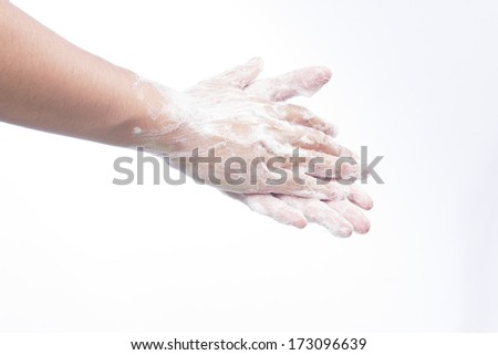 A man washes he hands with soap. Isolated on white - stock photo