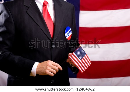 A man wearing a blue business suit and tie with a vote button.  Election day background or concept