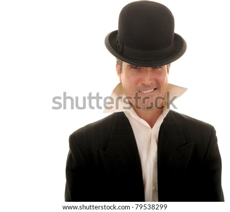 A man wearing a cocky grin and a bowler hat. - stock photo