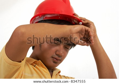 a man wearing a hard hat over a white background - stock photo