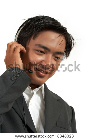 a man wearing a headset over a white background - stock photo