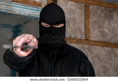 stock-photo-a-man-wearing-a-mask-hood-in