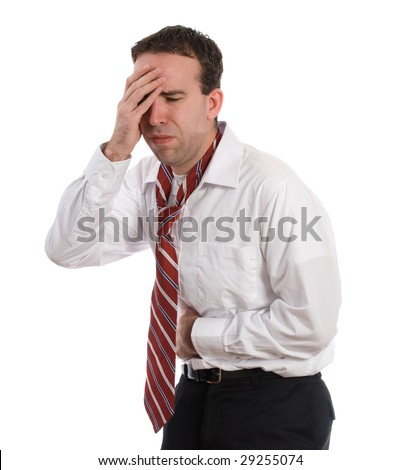 A man wearing a shirt and tie is feeling sick with the flu and running a fever - stock photo