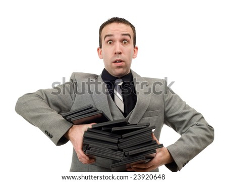A man wearing a suit carrying an armful of dvd cases, isolated against a white background