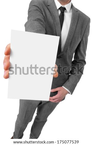 a man wearing a suit showing a blank signboard with a copy-space - stock photo